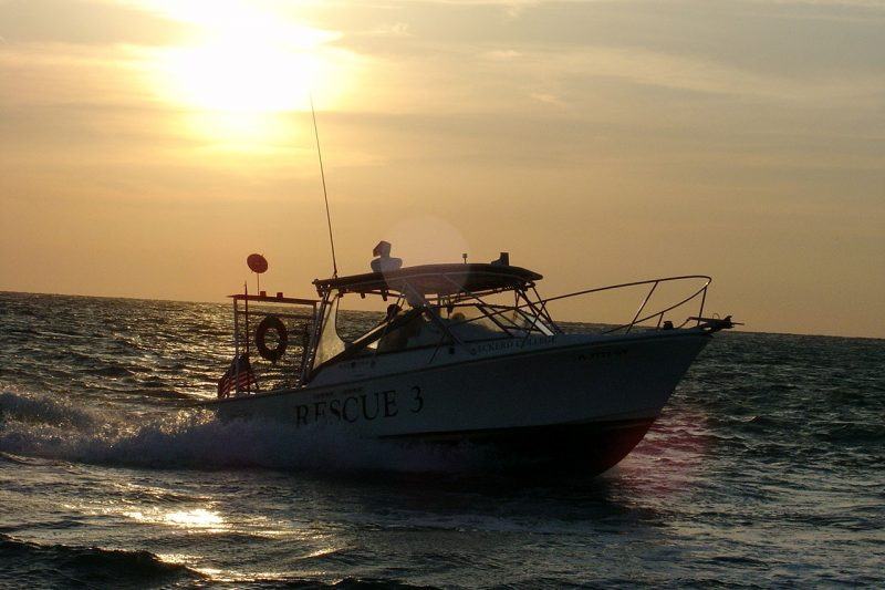 EC-SAR boat with sunset behind it