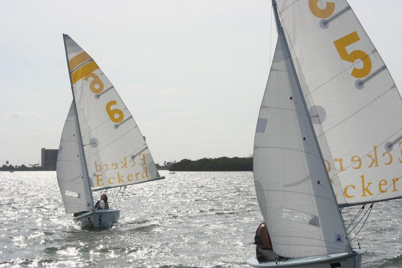 Two sailboats drifting out to sea