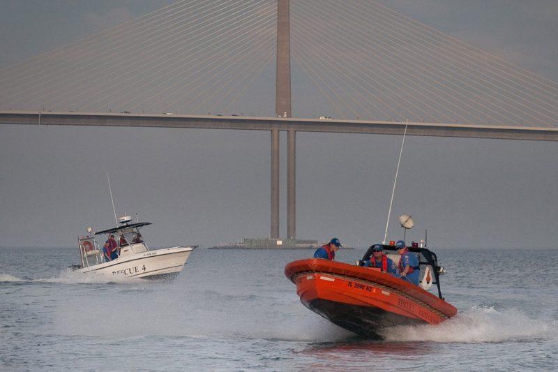 EC-SAR boats with Sunshine Skyway behind them