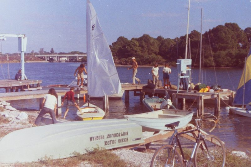 Old photo showing sailboat along water's edge