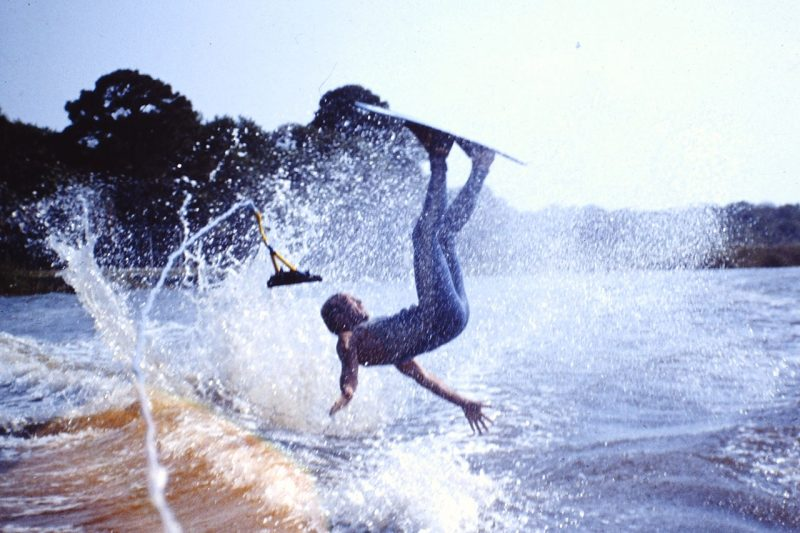 Student falling in water with jetski