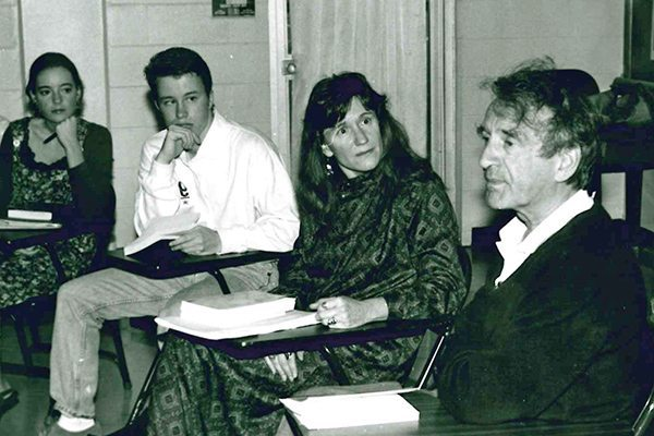 Carolyn Johnston and Elie Wiesel in a classroom with students