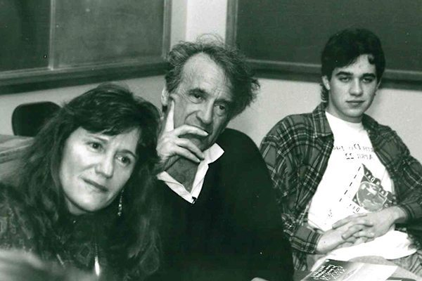 Elie Wiesel with Carolyn Johnston in a classroom
