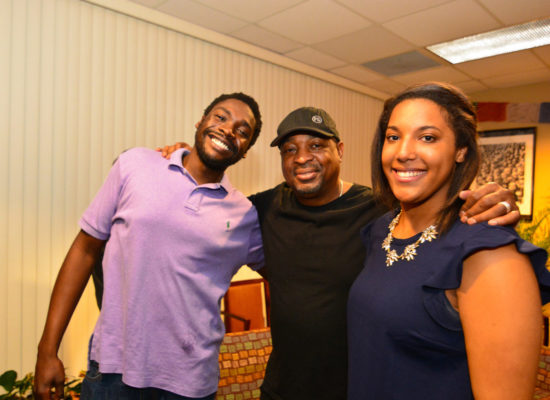 Chuck D. of the band Public Enemy, emcee, author, and producer with two students