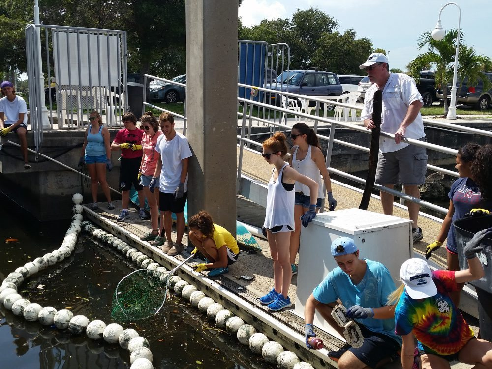 Students cleaning waterway with Tampa Bay Estuary Program