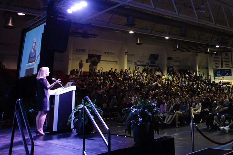 Piper Kerman speaking to audience in McCarthur Gym