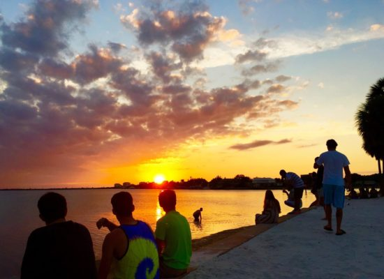 Students sitting on seawall at South Beach watching sunset by Sean Laughlin '17