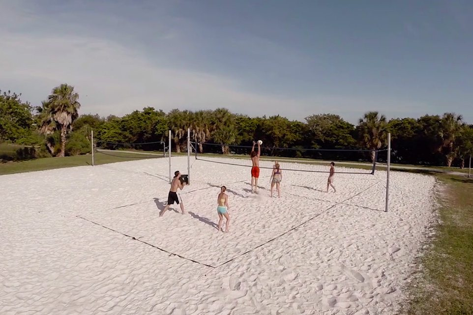 Students playing sand volleyball at the sand volleyball courts