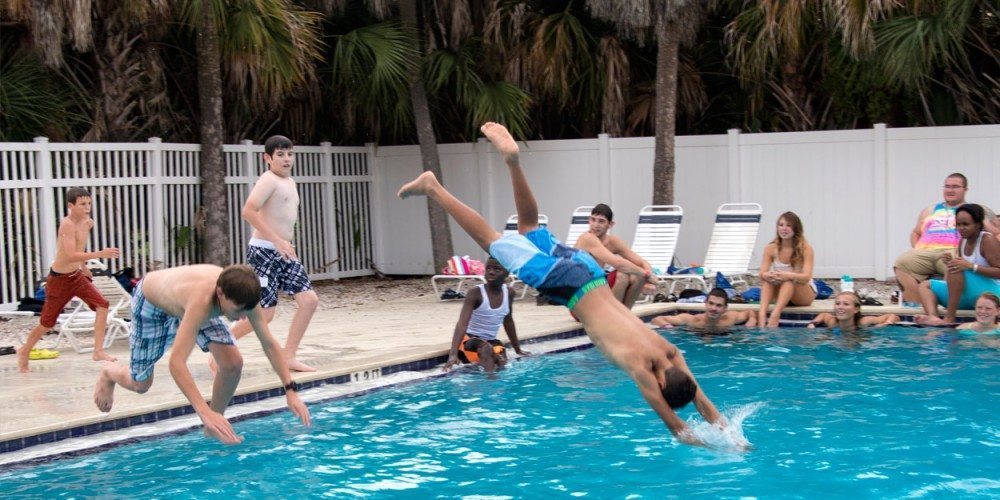 Summer Science Splash campers dive into the pool on Eckerd's campus