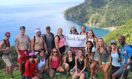 Students pose near cliff in Dominica