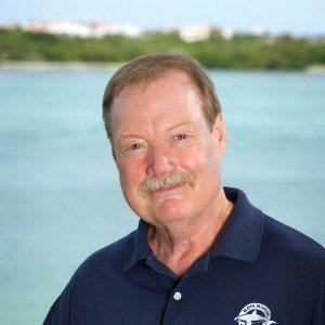 John Reynolds standing in front of water