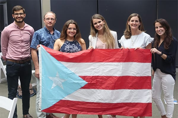 Students holding a Puerto Rico flag