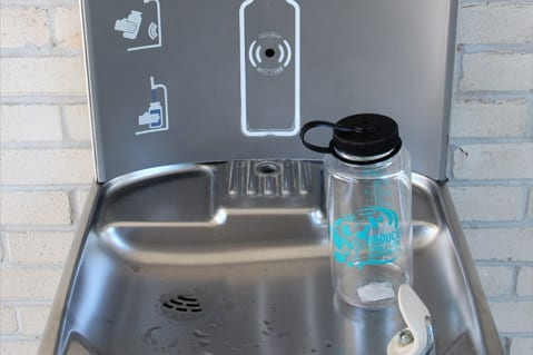 Water bottle filling station with reusable water bottle