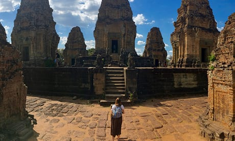 Student walking through Angkor Wat in Cambodia