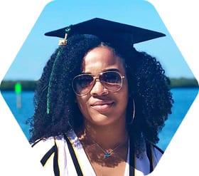 Anjali Boyd wearing graduation cap on South Beach