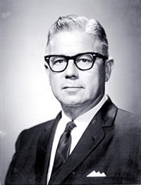 William H. Kadel wearing glasses